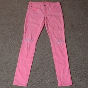 AEO Neon Pink Ripped Knee Skinny Jeans
